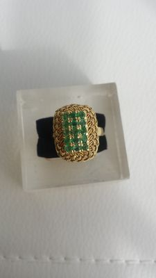 Gold ring with 15 emeralds