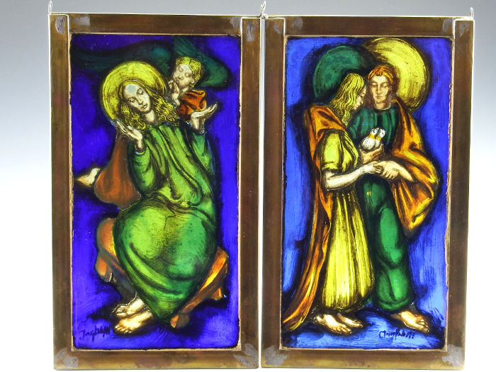 Set of two stained glass windows with a religious scene