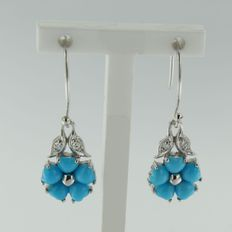14 kt white gold dangle earrings with synthetic turquoise and single cut diamond