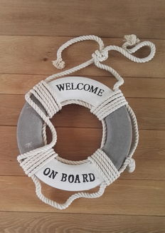 A wooden life buoy with lifebuoy rope