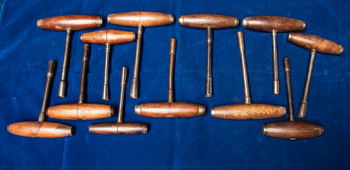 Twelve pianoforte tuning hammers and tuning keys. English, 19th century.