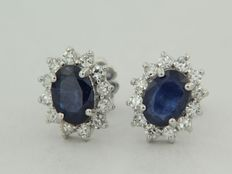 White gold rosette ear studs with sapphire and octagon cut diamond