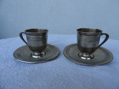 Two silver cups and saucer, Germany