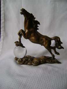 Bronze horse with legs on a glass world globe-Belgium-second half of the 20th century