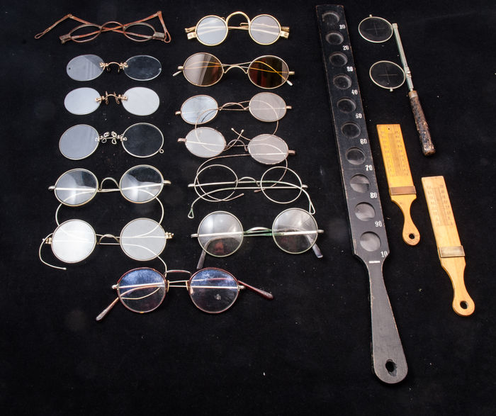 A collection of 18th and 19th century glasses and related optics.