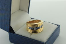 Yellow gold ring inlaid with diamonds and sapphires