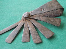 Wrought iron object, with clover mark - presumably 17th century