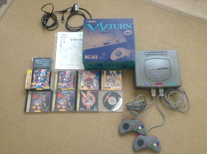 Sega Saturn - JVC V-Saturn console, complete in box, with 4MB RAM cart and  7 games - including Radiant Silvergun - Catawiki