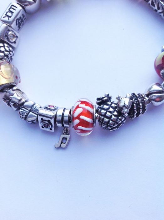 Silver Pandora bracelet with 20 Tedora charms  - Catawiki