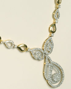 Set of gold necklace and earrings with diamonds
