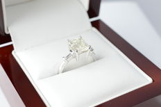 18 karat white gold ring set with a large, 2.00 carat emerald cut diamond.