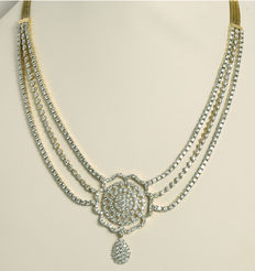 Set of gold necklace with 3 diamond strings and flower with earrings with diamonds