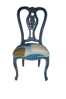 Beautiful blue stripped chair on white.