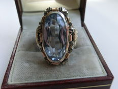 Ring, gold and silver and light blue topaz