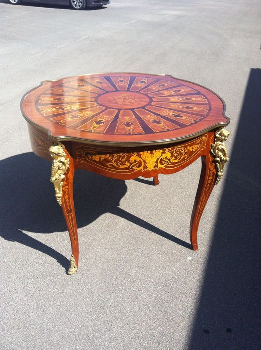 A Louis XV style marquetry circular table with two drawers and gilt bronze mounts, second half 20th century