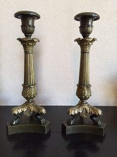 A pair of bronze candlesticks, France, first half of 19th century