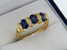 Ring in 18 kt gold + sapphires + diamonds