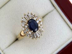 Gold ring set with sapphire and 26 diamonds