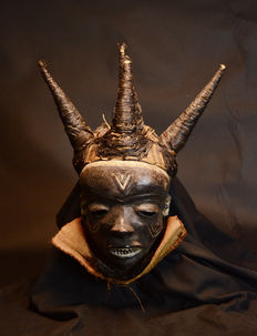African tribal Western Kwilu PENDE Mask with 4 black raphia horns. Democratic Republic Congo. D.R. Congo