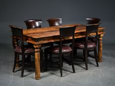 A wooden colonial table with six leather upholstered chairs, 21st century