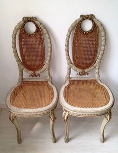 A pair of Napoleon III white painted and parcel gilt caned side chairs - France - circa 1880