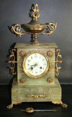 A green marble mantle clock - signed AD MOUGIN - around 1825