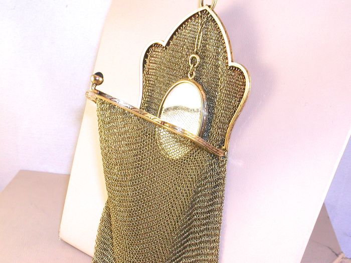 Antique gold money pouch set with cabochon sapphire and pearls.