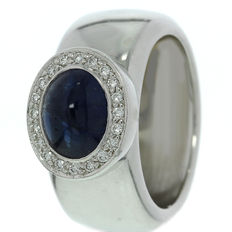 White gold women's ring set with sapphire and diamond.