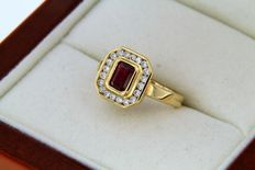 Gold Ring with a Ruby and entourage of 20 Diamonds