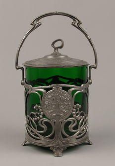 Art Nouveau pewter and green glass cookie jar, whip motif