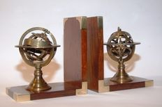 A pair of bookends in solid wood with bronzed armillary spheres. A collector's item.
