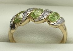 Peridot and diamond 9 kt gold ring