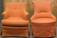 Two armchairs with salmon coloured upholstery, probably England, 20th century