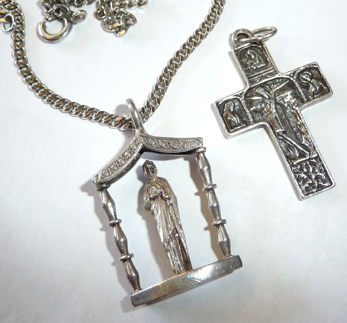 Two religious pendants a cross with religious depictions on both two religious pendants a cross with religious depictions on both sides a saint statue aloadofball Images