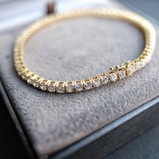 Yellow gold 14 kt, tennis bracelet with 59 brilliant cut diamonds, 5.9 ct in total