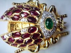 18 kt gold brooch with diamonds, rubies and emerald