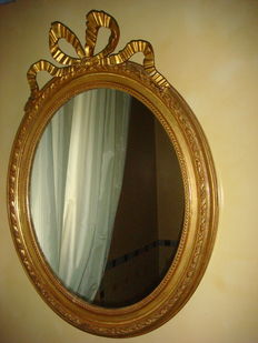 A Louis XVI style carved and gilt wood mirror, France - ca. 1920