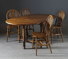 Jaycee Furniture Ltd., Four Windsor style dining chairs and a drop leaf table, England, circa 1970.