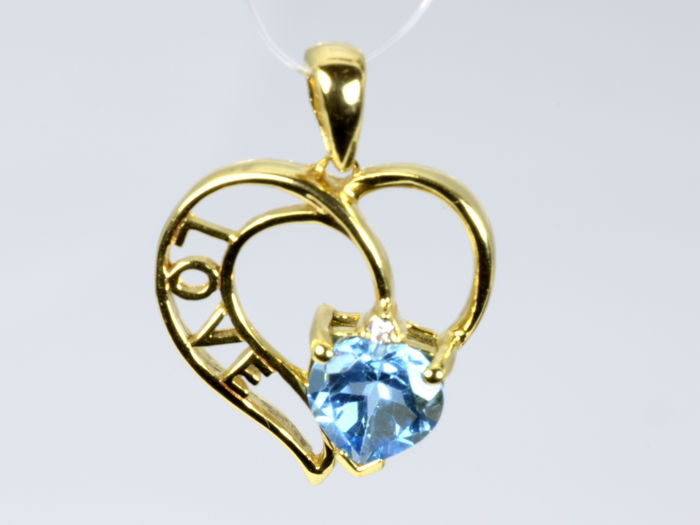14 kt gold heart shaped pendant with diamond and topaz catawiki 14 kt gold heart shaped pendant with diamond and topaz aloadofball Choice Image