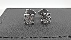 0.94 ct, D/VS2-SI1 round diamond stud earrings 14 kt white gold