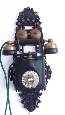 Antique wall telephone - cast iron and bakelite