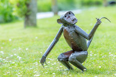 Statuette of a kneeling metal monkey