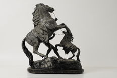 Sculpture of horses. In metal