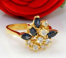 Gold ring set with seven diamonds and four sapphires
