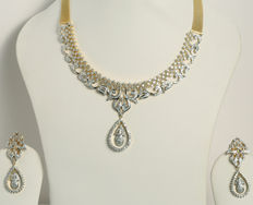 Diamond necklace and chandelier earrings