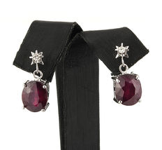 White gold earrings with 2 brilliant-cut diamonds, 0.15 ct total and set with 2 oval cabochon cut rubies, 8 ct in total.