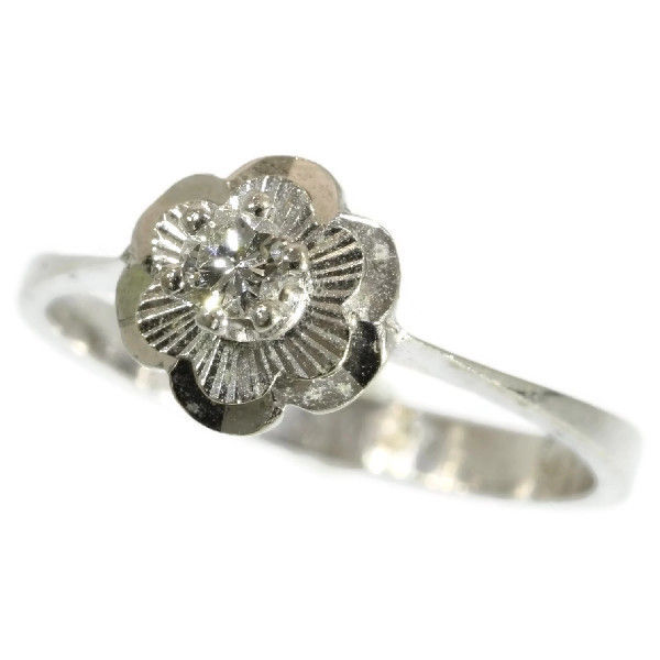white gold flower shaped engagement ring with 1 brilliant