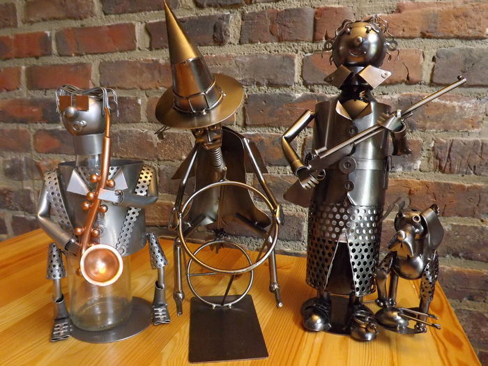 3 Characters Wine Bottle Holders In Assembled Metal Catawiki
