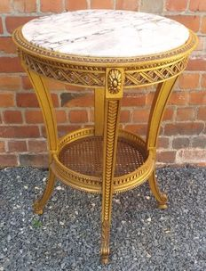 A Louis XVI style gilt wooden side table with marble top, Italy, 20th century.