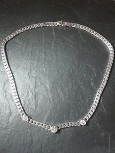 Brilliant necklace/tank chain, 18 kt white gold with three brilliants (VVS/VS, F/G) total 1.95 ct HRD certificate